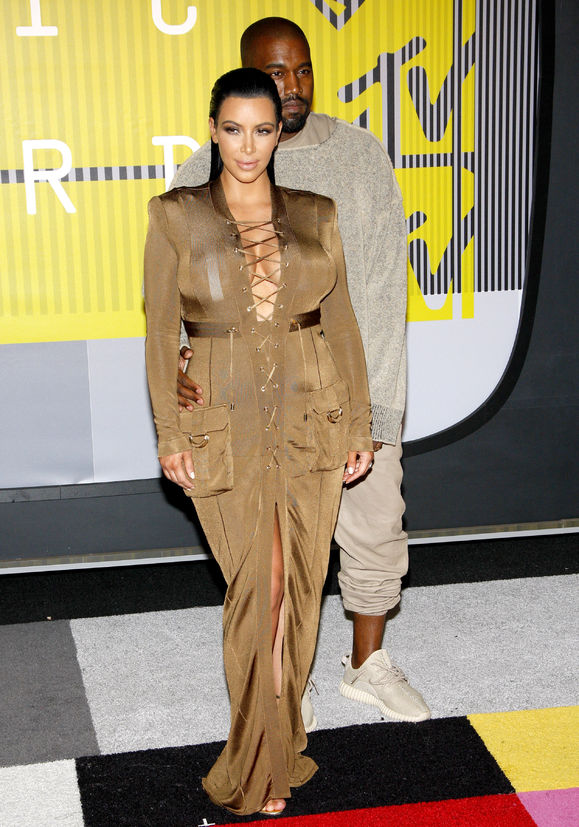54607966 - kanye west and kim kardashian at the 2015 mtv video music awards held at the microsoft theater in los angeles, usa on august 30, 2015.